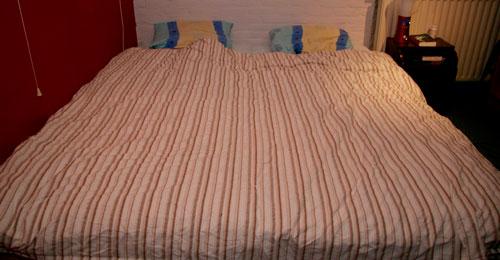 Het grote houten bed